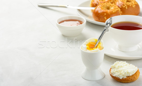 Breakfast of boiled egg and brioche buns Stock photo © markova64el