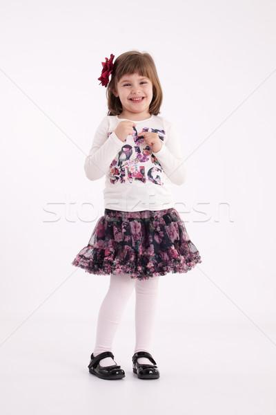 Bambina modello gonna fiore capelli Foto d'archivio © maros_b