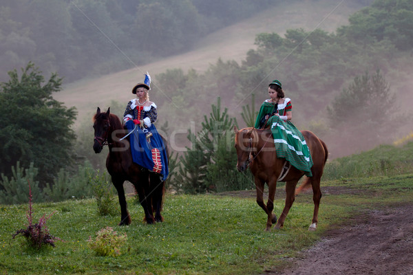 Two women in the royal baroque dress riding Stock photo © maros_b