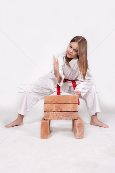 Karate lány téglák kimonó kéz kezek Stock fotó © maros_b