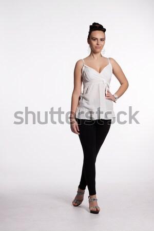 интересный прическа белая блузка черный леггинсы Сток-фото © maros_b