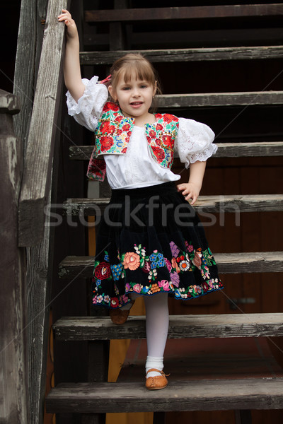 Little girl in traditional costume on the stairs Stock photo © maros_b