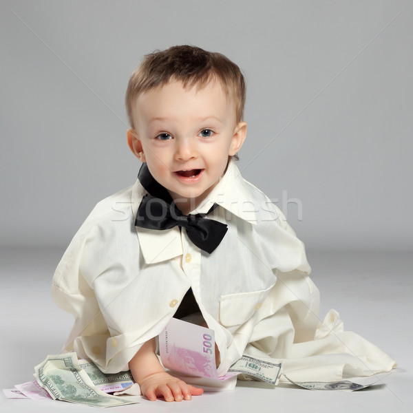 Kisgyerek fiú üzletember ül csokornyakkendő köteg Stock fotó © maros_b