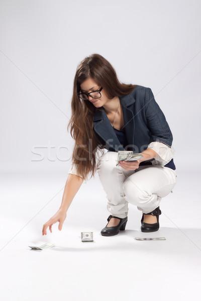 Fiatal nő pénz padló dollár kéz Stock fotó © maros_b