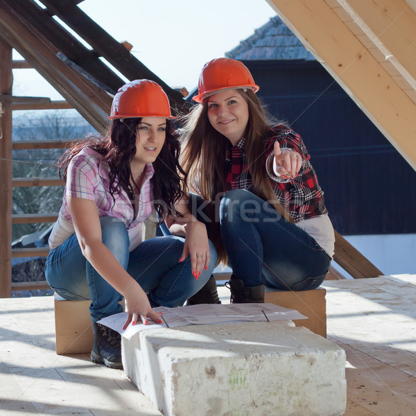 Two young women workers on the roof Stock photo © maros_b