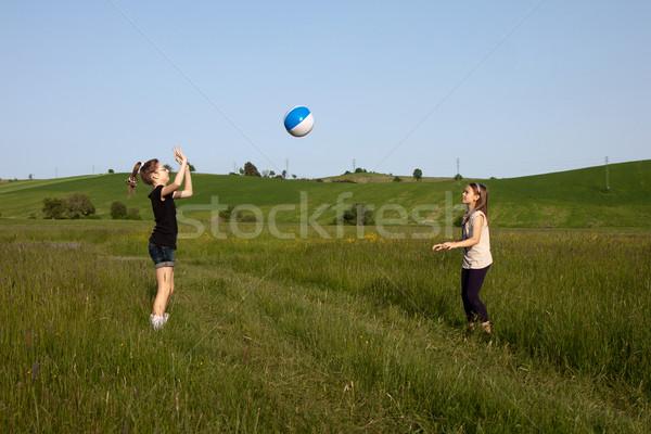 Historia rozdarty piłka dwa teen dziewcząt Zdjęcia stock © maros_b
