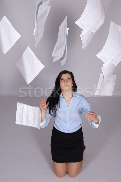 Nő ki papír levegő fiatal nő térdel Stock fotó © maros_b