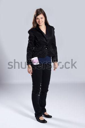Jovem mulher dinheiro em pé bolso muitos Foto stock © maros_b