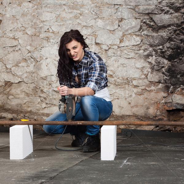 Jovem mulher ângulo cortar ferro Foto stock © maros_b