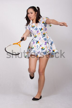 A girl with pigtails in colorful retro dress Stock photo © maros_b