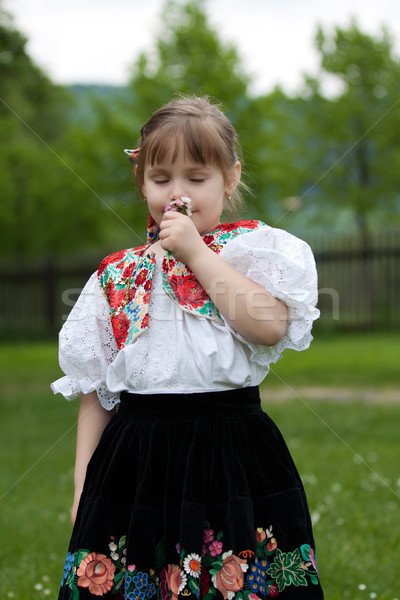 Little girl in traditional costume with flowers Stock photo © maros_b