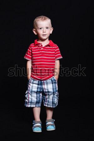 Piccolo ragazzo studio strisce shirt Foto d'archivio © maros_b