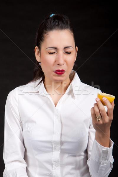 Femme manger jaune citron mains tenant main Photo stock © maros_b