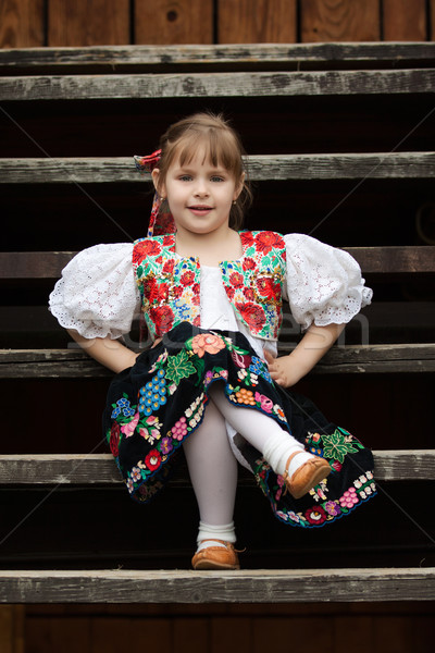 Sitting little girl in traditional costume Stock photo © maros_b