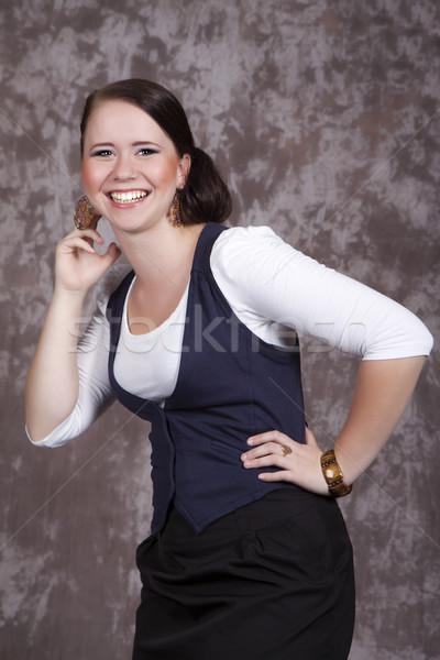 Menina cabelos longos branco camisas azul colete Foto stock © maros_b
