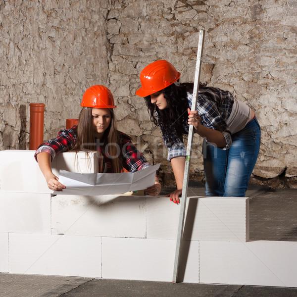 два молодые женщину новых стены блоки Сток-фото © maros_b