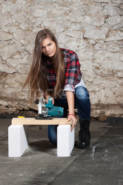 Jovem mulher serra madeira reparar Foto stock © maros_b