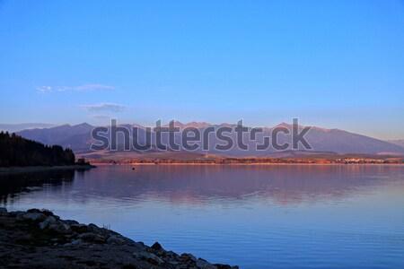 Outono lago montanhas céu reflexão paisagem Foto stock © maros_b