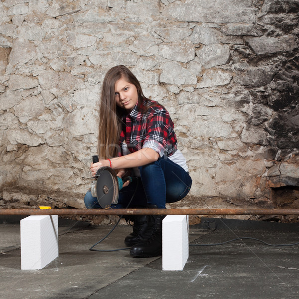 Young long-haired woman with an angle grinder Stock photo © maros_b