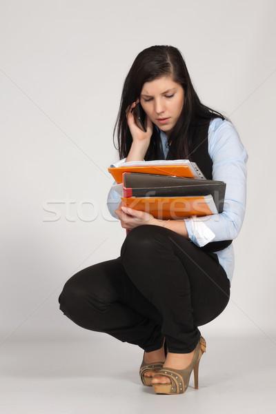 Fiatal nő telefon iratok kezek papír munka Stock fotó © maros_b