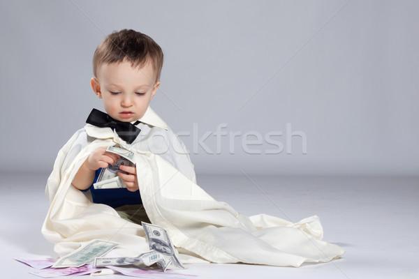 Criança menino empresário sessão dinheiro Foto stock © maros_b