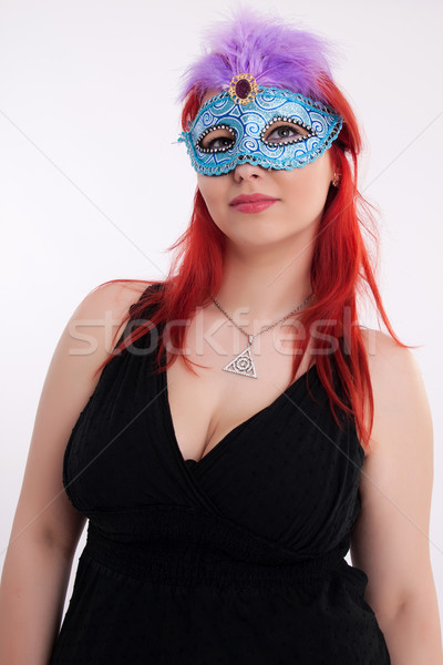 Young plump red-haired woman with mask Stock photo © maros_b