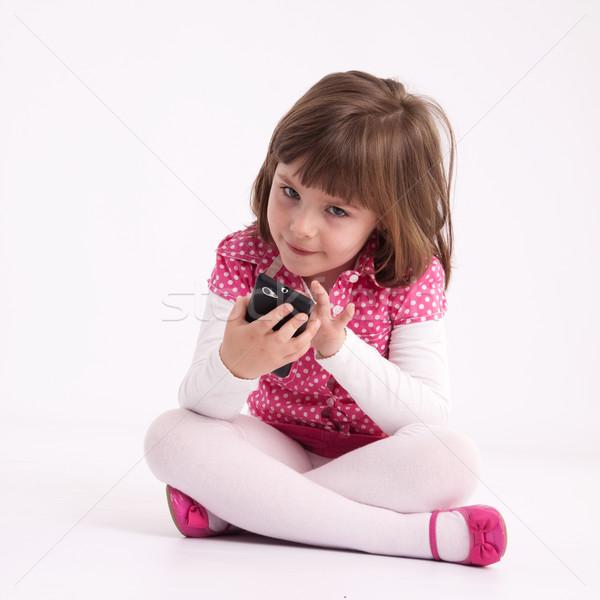 Küçük kız okul öncesi model pembe etek sandalet Stok fotoğraf © maros_b
