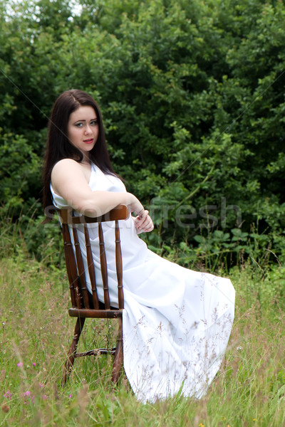Woman on old chair Stock photo © maros_b