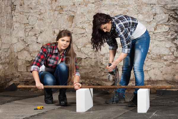 Two long-haired young woman with an angle grinder Stock photo © maros_b