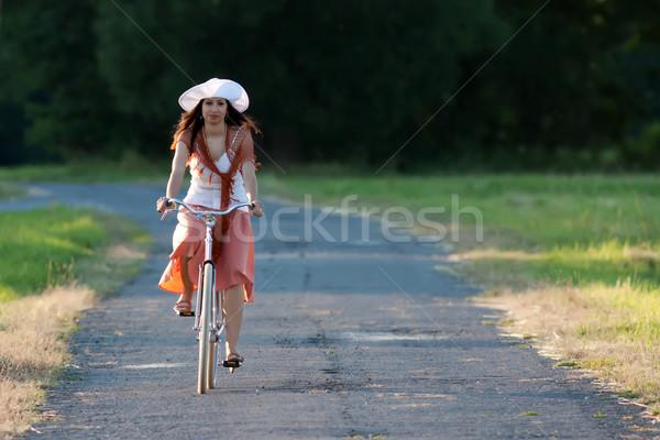 Retro lány öreg bicikli nő narancs Stock fotó © maros_b