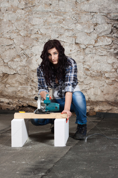 Young long-haired woman with a circular saw Stock photo © maros_b