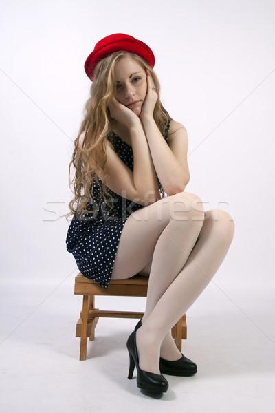 Fiatal fürtös szőke nő ül szomorú lány Stock fotó © maros_b