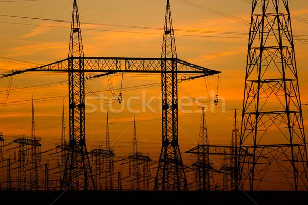 Foto stock: Torres · alta · tensão · pôr · do · sol · nuvens · rede · indústria