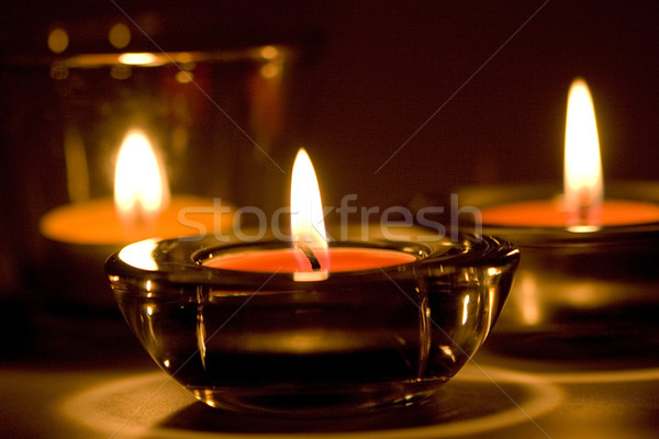 Tre candele fiammeggiante buio primo piano fuoco Foto d'archivio © marylooo