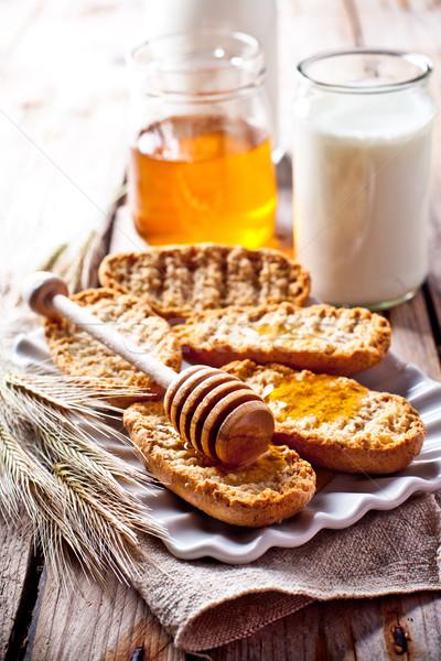 crackers, milk and honey  Stock photo © marylooo