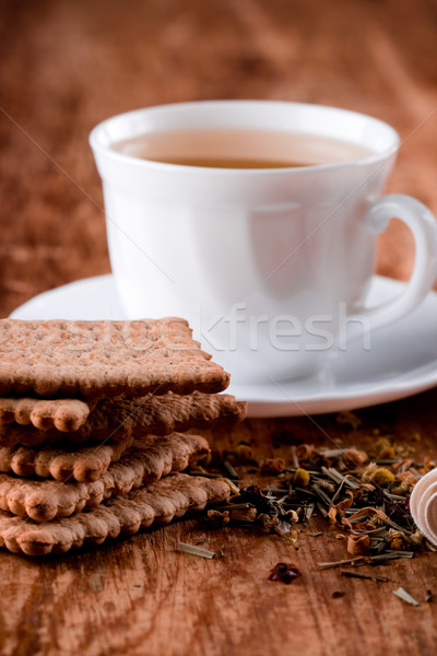 cup of fresh herbal tea and some cookies  Stock photo © marylooo