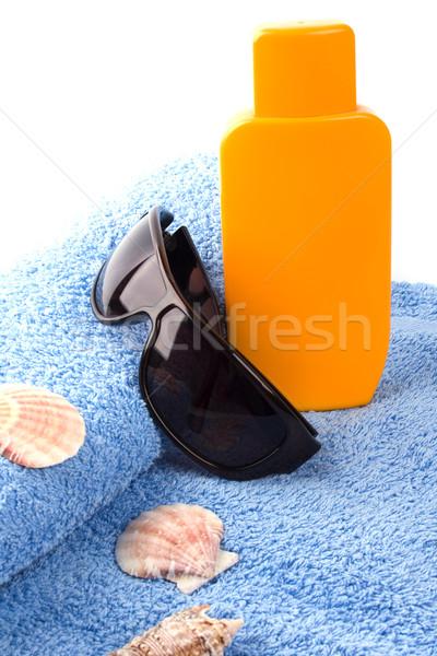 Handtuch Sonnenbrillen Lotion Sonne Hintergrund Stock foto © marylooo