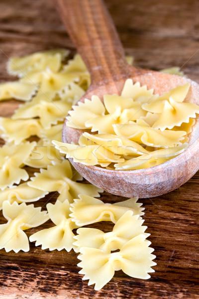 uncooked pasta in wooden spoon Stock photo © marylooo