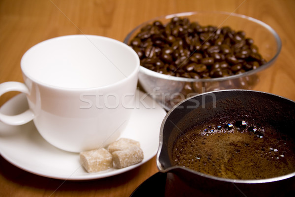 cup, coffee, sugar and beans in glass bowl Stock photo © marylooo