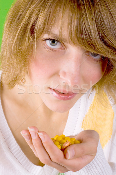 Nő halom citromsárga tabletták közelkép portré Stock fotó © marylooo