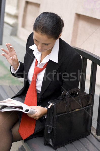 businesswoman reading magazine Stock photo © marylooo