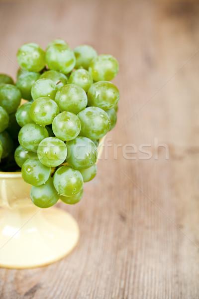 fresh green grapes in a yellow bowl  Stock photo © marylooo