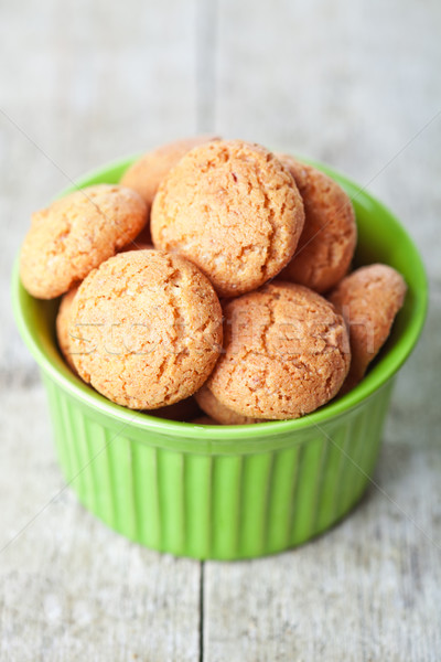 Mandorla cookies ciotola legno zucchero cookie Foto d'archivio © marylooo