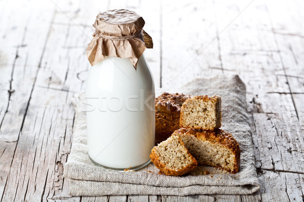 bottle of milk and fresh baked bread  Stock photo © marylooo