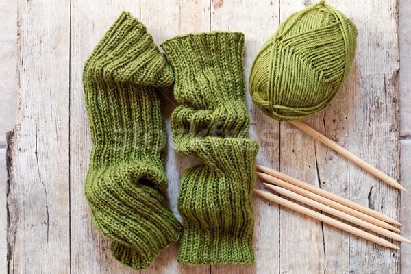 wool green legwarmers, knitting needles and yarn Stock photo © marylooo