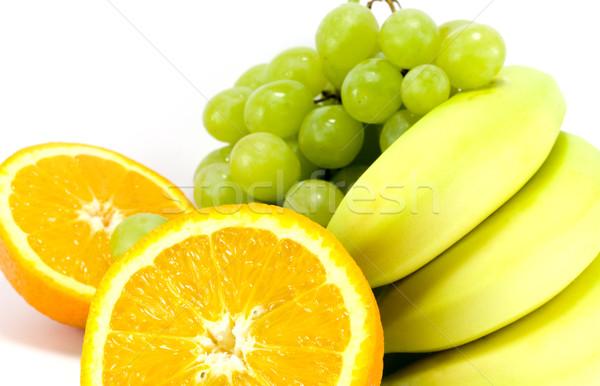 grapes, bananas and two halves of orange Stock photo © marylooo
