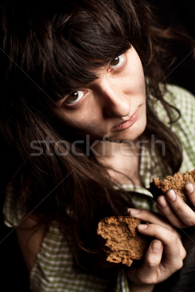 Mendiant femme pain portrait pauvres fille Photo stock © marylooo