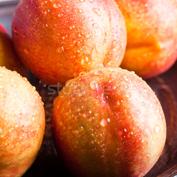 Fresco gotas de água comida fundo laranja Foto stock © marylooo