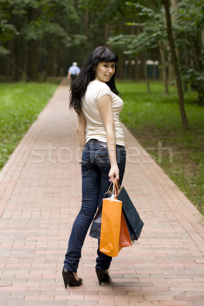 brunet girl with shopping bags Stock photo © marylooo