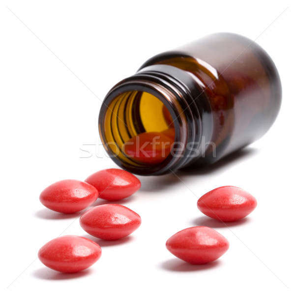 Botella rojo pastillas vidrio blanco medicina Foto stock © marylooo